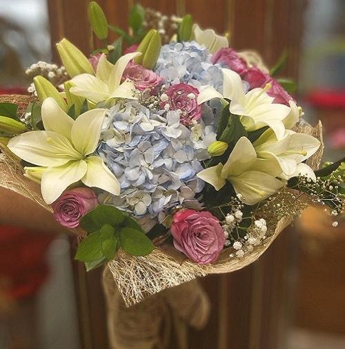 Flower bouquet with blue hydreangea