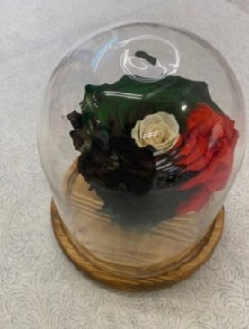 Single Infinite Flower in UAE  Flag Design in Glass Case